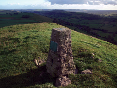 Ordnance Survey pillar on the summit of High Wheeldon looking down the Dove valley to Sheen Hill